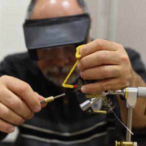 Haliburton Fly Fishing Club's Steve Galea Works On Tying A Fly. / Darren Lum Of The Haliburton Echo