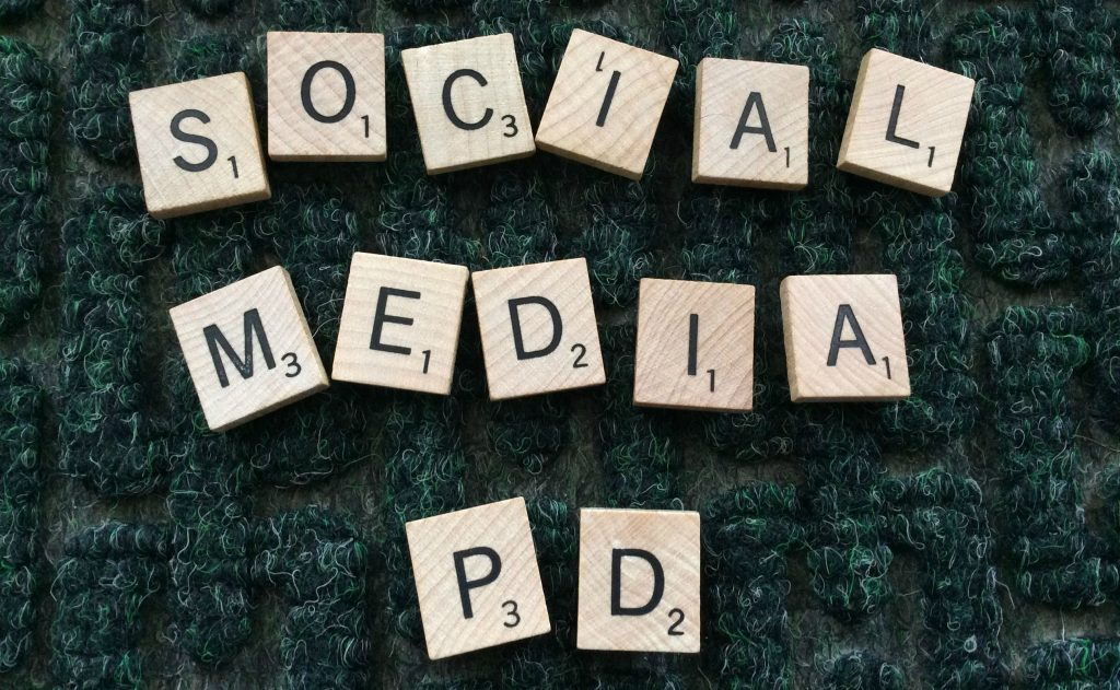 Scrabble tiles spelling Social Media PD