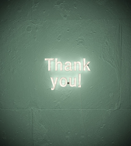 """Thank you"" written on a wall."