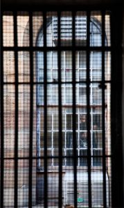 Photo of a barred window.