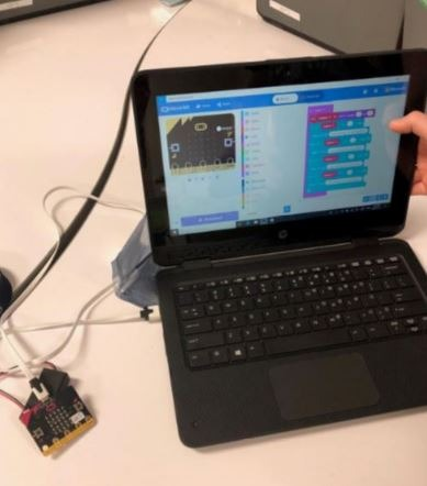 Image of a laptop with a circuit attached.