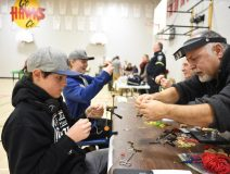 Student Learning How To Tie A Fly From Steve Galea. / Darren Lum Of The Haliburton Echo.