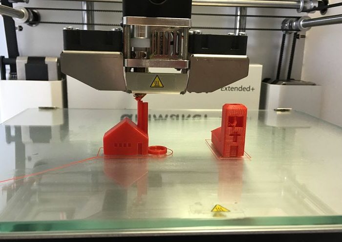 3D Printer Prints 2 Miniature Buildings