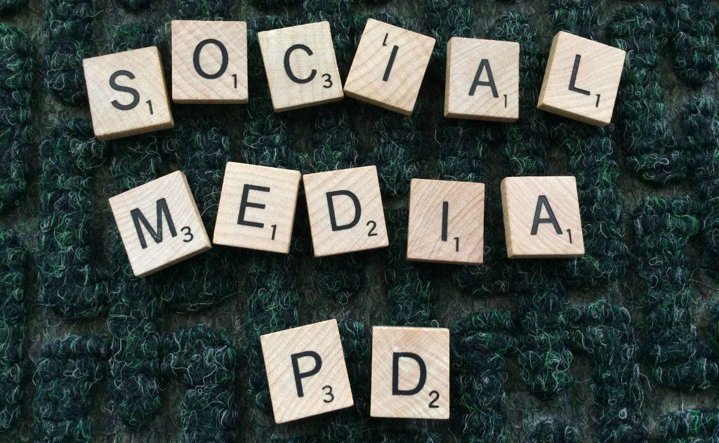 Scrabble tiles spelling Social Media PD