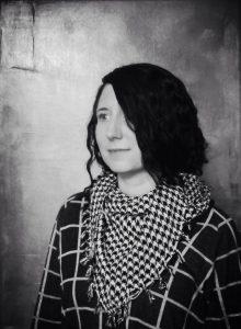 Black and white portrait of Corinne Abba