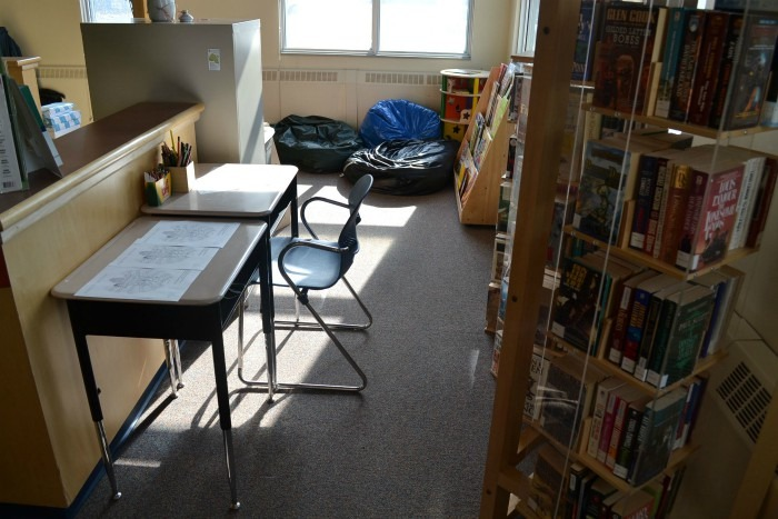 Inside photo of Sachigo Lake First Nation library featuring books shelves and desks.