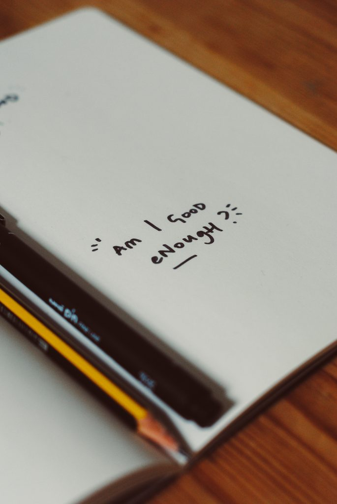 """Notebook with text """"am I good enough"""""""