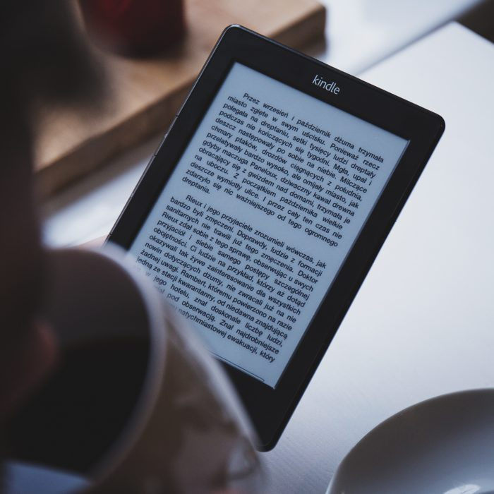 A Person Reading An Ebook.