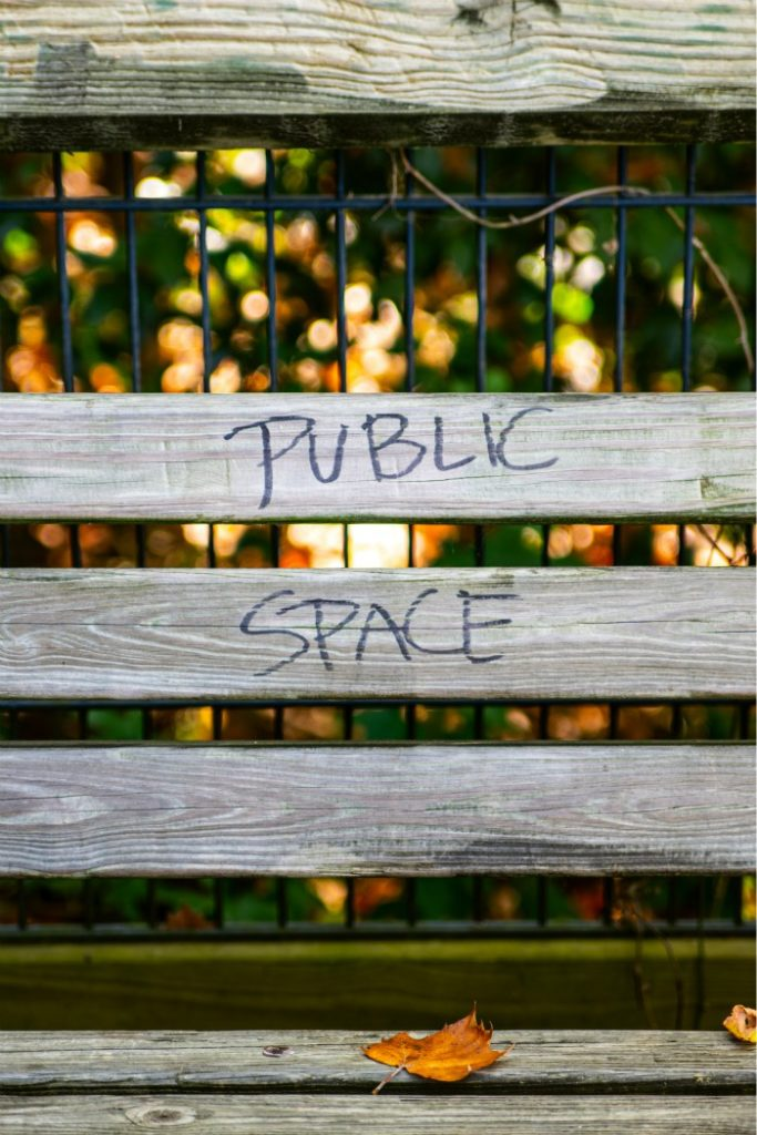 A fence painted with the slogan public space