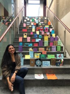 iSchool intern Sabrina Macklai with some of the holiday cards before they were sent to a local senior residence.