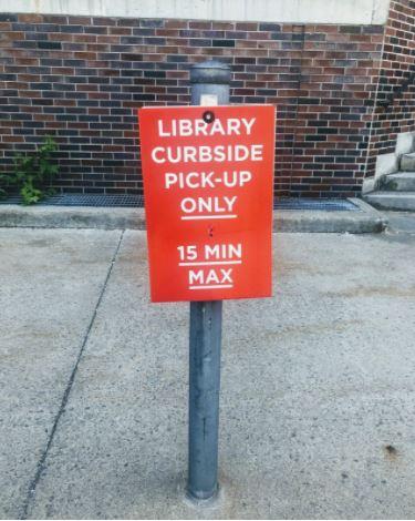 Carleton University Red Sign For Curbside Pickup Parking