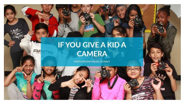Large group of children with the caption Give a kid a camera