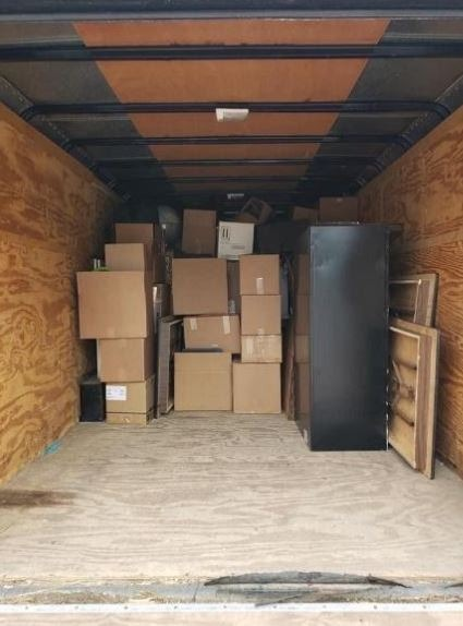 Cardboard boxes in a moving van