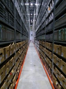 High density shelving stretches into the distances, holding material from the U of T Music Library