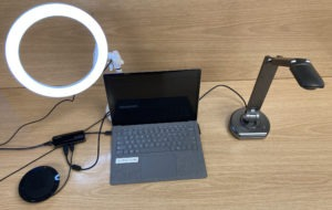 A streaming setup from the top including a ring light, laptop and a document camera