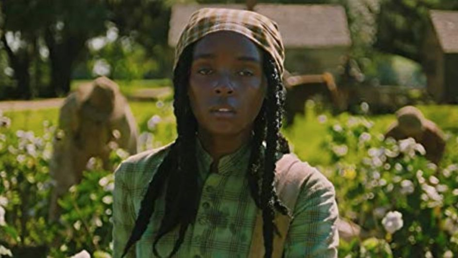 Janelle Monáe stands in a cotton field in the film Antebellum