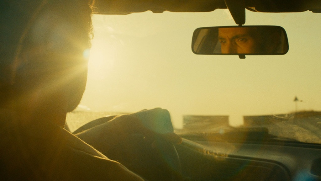 Yannis Stankoglou stares into his rearview mirror in the film Blind Sun