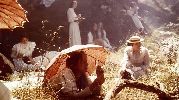 School girls lay in the oppressive heat under parasols in the flim Picnic at Hanging Rock