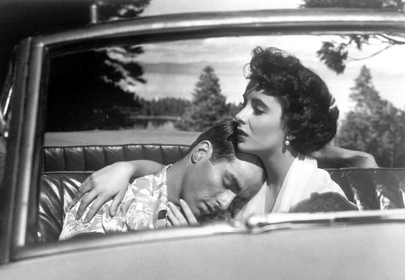 Montgomery Clift leans on the shoulder of Shelley Winters in the flim A Place in the Sun