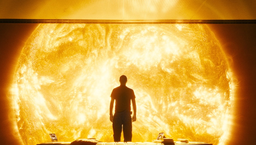 A figure stands, silhouetted against the burning sun in the film Sunshine